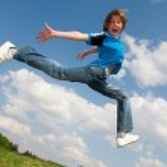 Happy boy run against beautiful sky — Stock Photo #4711550