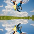 Girl and boy jumping — Foto de Stock