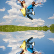 Stock Photo: Girl and boy jumping