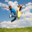 Girl and boy jumping — Stockfoto #4711571