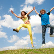 Girl and boy jumping — Stockfoto #4711583