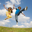 Royalty-Free Stock Photo: Girl and boy jumping. Soft focus. Focus on eyes