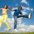 Girl and boy jumping - Stockfoto