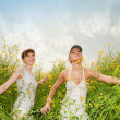 Two happy young women in field — Stock Photo #4711884