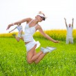 Happy is jumping in a field — Stock Photo