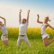 Happy is jumping in field — Stock Photo #4711909