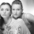 Two beautiful young woman. Soft focus. In studio. — Stock Photo