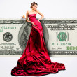 Beautiful girl in red dress with money, 100 american dollars — Stock Photo