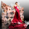 Beautiful girl in red dress against fantasy butterfly luminous — Stock Photo #4712101
