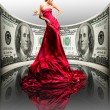 Beautiful girl in red dress, money. 100 american dollars — Stock Photo