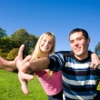 Young love couple smiling under blue sky — Stock Photo