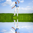 Happy man is jumping in a field — Stock Photo