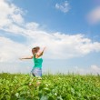 Beautiful young woman on a green meadow — Stock Photo #4712478