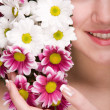 Attractive girl face with flowers — Stock Photo #4712801