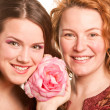 Mother and daughter with flower. Focus on eyes — Stock Photo #4713021