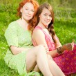 Stock Photo: Funny mother and daughter on green grass