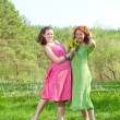 Funny mother and daughter on green grass — Stock Photo #4713096