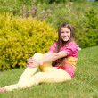 Pretty smiling girl relaxing on green meadow. Soft focus. Focus — Stock Photo