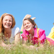 Mother and daughter on green meadow — Stock Photo