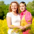 Mother and daughter on green meadow — Stock Photo #4713225