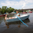 Mom and Daughter relax in boat - Stock Photo