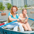 Mom and Daughter relax in boat — Stock Photo