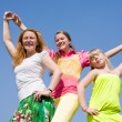 Happy Mother and two daughter jumping — Stock Photo