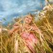 Little girl in wheat field — Stock Photo #4713299