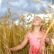 Little girl in wheat field — Stock Photo