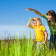 Stock Photo: Happy Mother and Daughter on Field. Girl Surprised Something.
