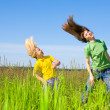 Happy mother and daughter making exercises on field. — Stock Photo