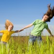 Royalty-Free Stock Photo: Happy woman and girl making exercises on field.