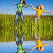 Happy mother and daughter on field — Stock Photo