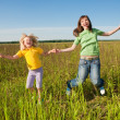 Happy mother and daughter at field — Stock Photo