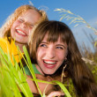 Happy mother and daughter on garden — Stock Photo