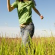 Happy young women running in field — Stock Photo
