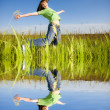 Happy jumping young woman — Stock Photo