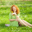 Smiling young woman in green grass — Stock Photo #4713822