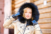 Portrait smiling young woman with a fur hood. Photography for fa — Stock Photo