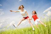 Mom and Daughter Having Fun in field — Stock Photo
