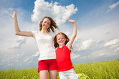 Mom and Daughter Having Fun in the field — Stock Photo