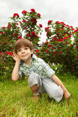 Happy boy enjoy on meadow Listening — Stock Photo
