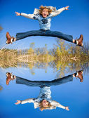 Happy jumping boy. Reflected in the water — Stock Photo