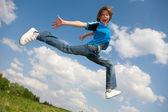 Happy boy run against beautiful sky — Stock Photo