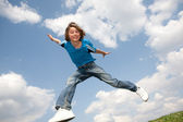 Happy jumping boy. Soft focus. Focus on eyes — Stock Photo
