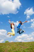 Girl and boy jumping. Soft focus. Focus on eyes — Stock Photo