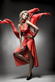Luxury woman in red dress — Stock Photo