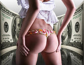 Buttocks decorated with flowers under money, 100 american dollar — Stock Photo