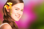 Portrait Beautiful girl with flower. Focus on eyes — Stock Photo