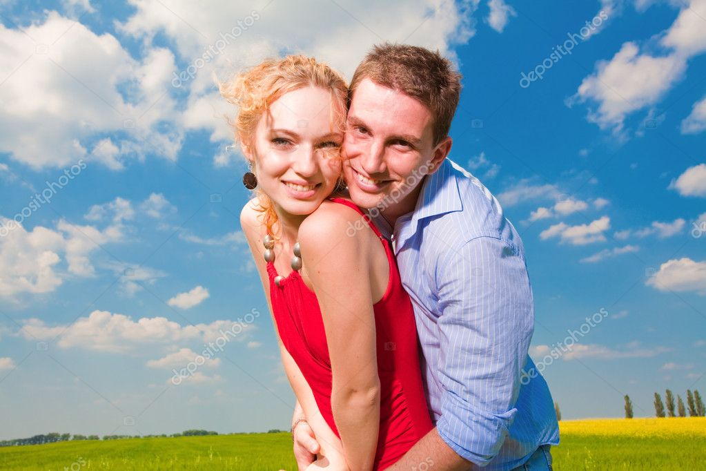 Young love Couple smiling under blue sky — Stock Photo #4710643